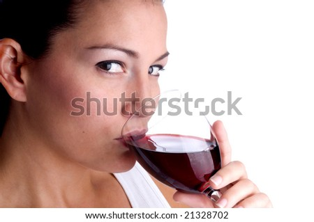 Attractive young woman sipping a glass of red wine