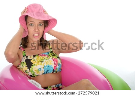 Attractive Young Woman Sitting in Rubber Rings Wearing a Swimsuit - stock photo