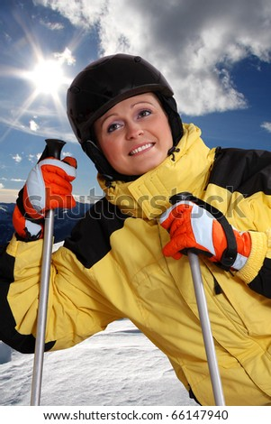 attractive young woman skiing - stock photo