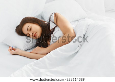 Attractive young woman sleeping in bedroom. Healthy lifestyle. Wellness concept - stock photo