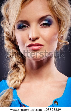 attractive young woman stares into the camera. Close-up portrait - stock photo