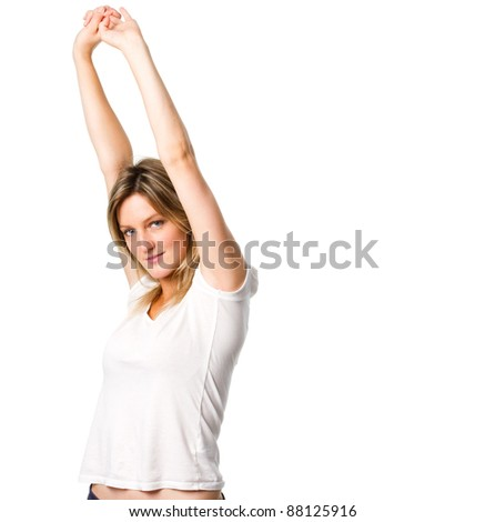 Attractive young woman stretching her arms