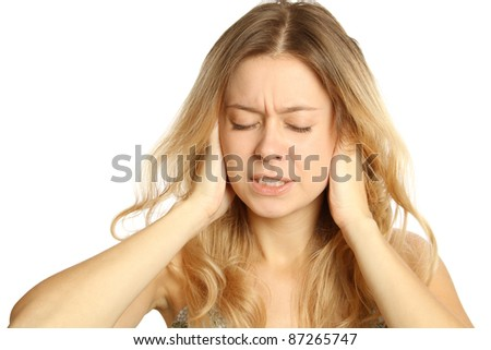 Attractive young woman suffering from headaches. Isolated on white background