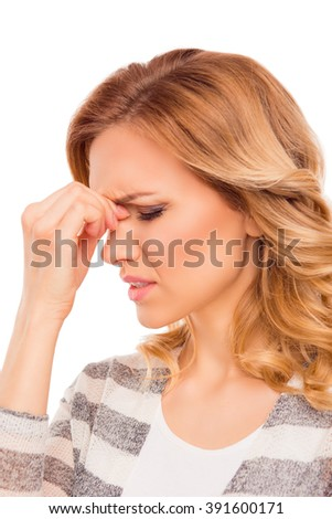 Attractive young woman suffering of strong headache - stock photo