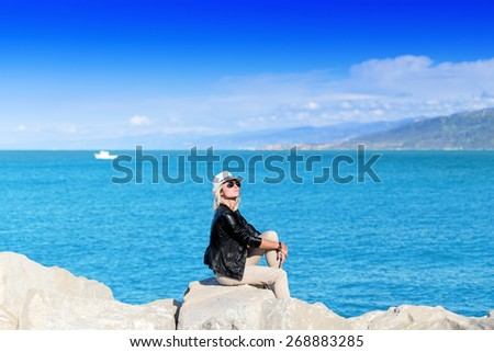 Attractive young woman sunbathing - stock photo