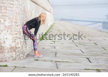 Attractive young woman taking a break from hard morning workout - stock photo