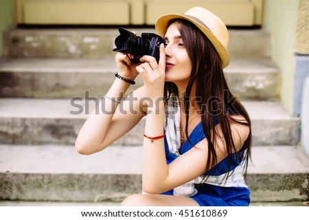 attractive young woman talking pictures outdoors - stock photo