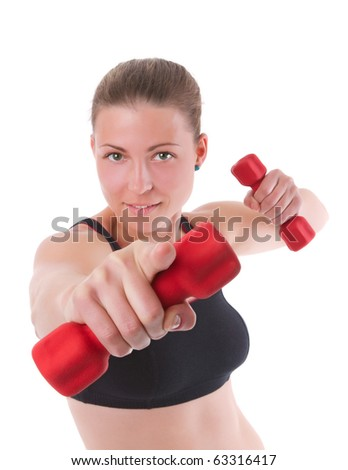 Attractive young woman training with hand weights and pointing her finger at you - stock photo