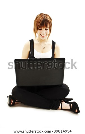 Attractive young woman using notebook computer. Isolated on white background - stock photo