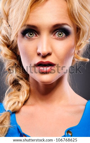 attractive young woman watch in amazement into the camera. Close-up portrait - stock photo