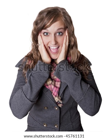 Attractive young woman wearing a winter jacket with a surprised or elated expression. Isolated on a white background - stock photo