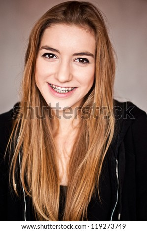 attractive young woman wearing braces with pretty smile - stock photo