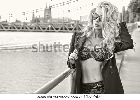 Attractive young woman wearing sunglasses - stock photo