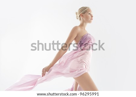 Attractive young woman wearing transparent silk fabric. - stock photo