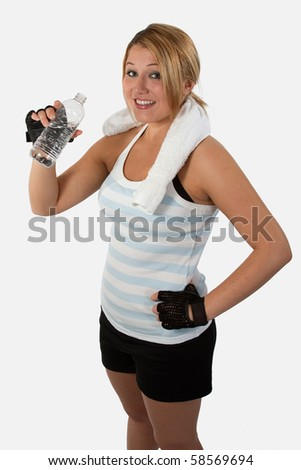 Attractive young woman wearing workout attire holding a water bottle - stock photo