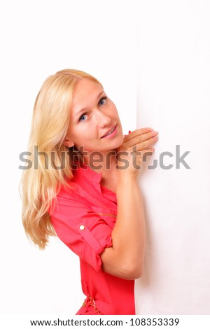 Attractive young woman with a big sheet of paper - stock photo