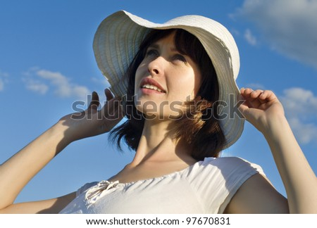Attractive young woman with a hat - stock photo
