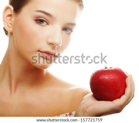 attractive young woman with an apple - stock photo