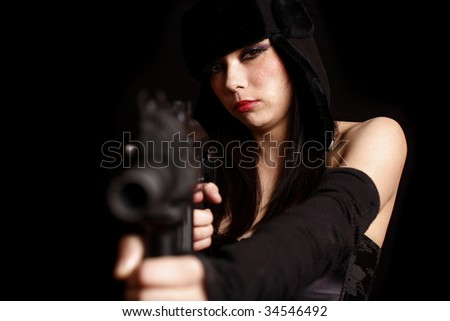 Attractive young woman with assault gun.