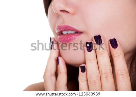 Attractive young woman with beautiful manicured nails - stock photo