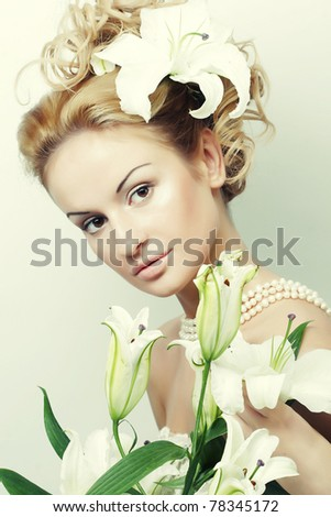 Attractive young woman with beautiful wedding hairstyle - stock photo