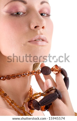 Attractive young woman with big beautiful jewellery - stock photo