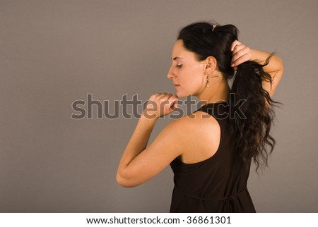 attractive young woman with black hair - stock photo