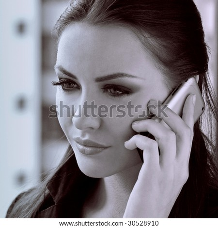 attractive young woman with cell phone - stock photo