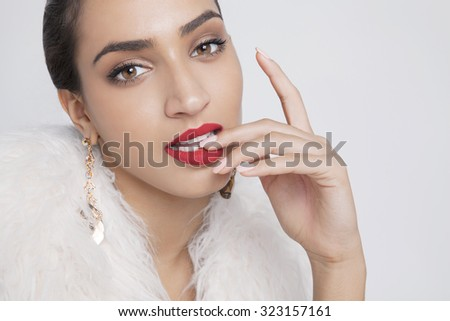 attractive young woman with clean fresh skin and red lips. Close up portrait, studio shot. Horizontal. - stock photo
