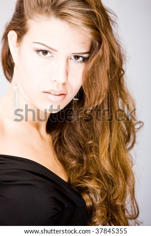 attractive young woman with curly splendid long hair and opened mouth