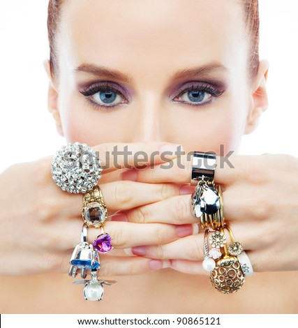 Attractive young woman with diamonds on the hands on the white background - stock photo