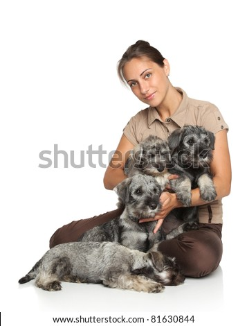 Attractive young woman with dogs Miniature and Mittelschnauzer puppies on a white background - stock photo