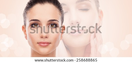 Attractive young woman with glowing face skin smiling and posing - stock photo