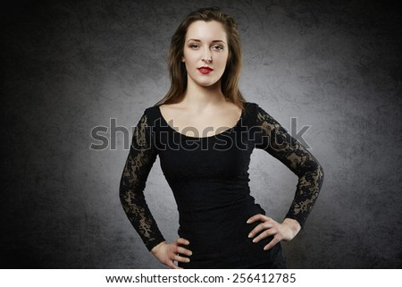 Attractive young woman with hands on her hips - stock photo