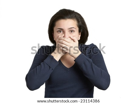 Attractive young woman with hands over mouth, speak no evil - stock photo
