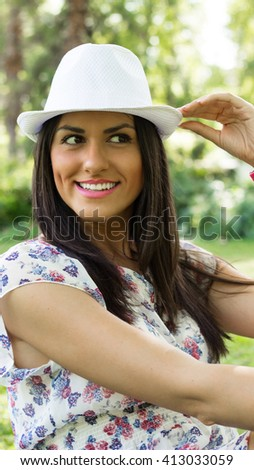 Attractive young woman with hat - stock photo