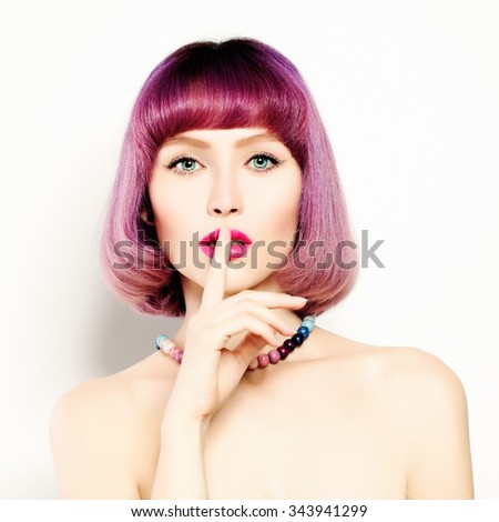Attractive Young Woman with her Finger on her Lips. Girl Shushing - stock photo