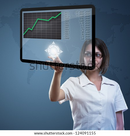 Attractive young woman with  high tech panel - stock photo