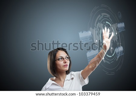 Attractive young woman with interface - stock photo