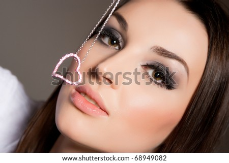 Attractive young woman with jewelery, close up shot - stock photo