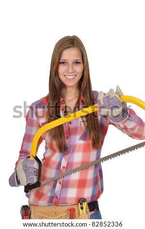 Attractive young woman with long hair holding a large saw - stock photo