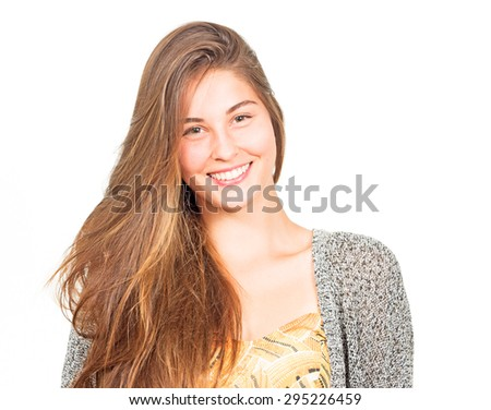 attractive young woman with long hair laughing - stock photo