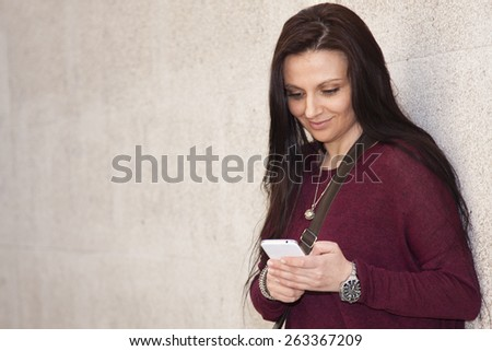 attractive young woman with mobile phone - stock photo
