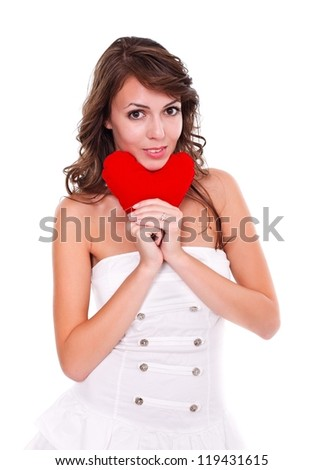 Attractive young woman with red heart in hand, white background - stock photo