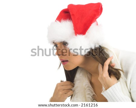 Attractive young woman with Santa Claus hat looking - stock photo