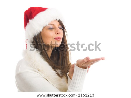 Attractive young woman with Santa Claus hata hand - stock photo
