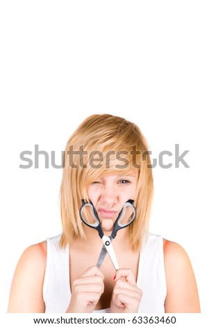 attractive young woman with scissors isolated on white background - stock photo