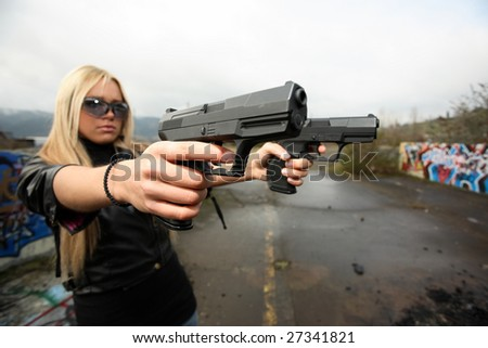 Attractive young woman with two guns.
