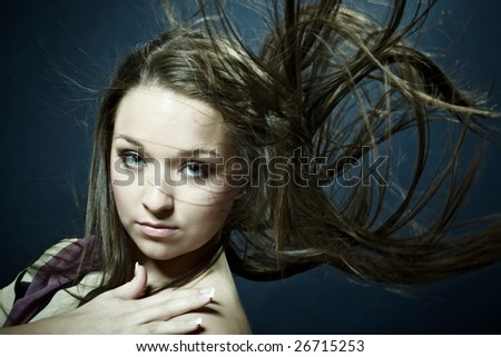 Attractive young woman with wind in hair