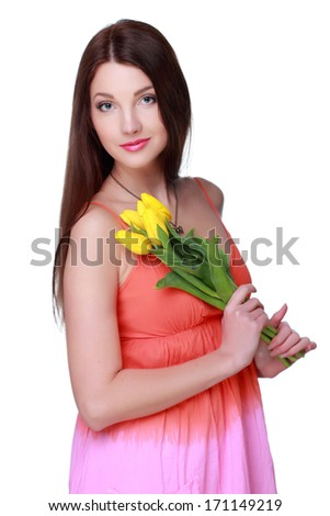 Attractive young woman with yellow tulips/Beautiful girl holding a bouquet of fresh flowers on Holiday